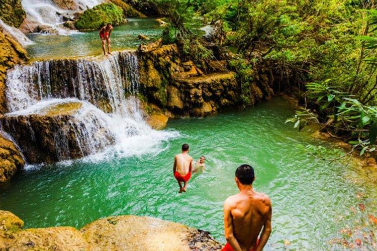 Relaxing at Kuang Si Waterfall